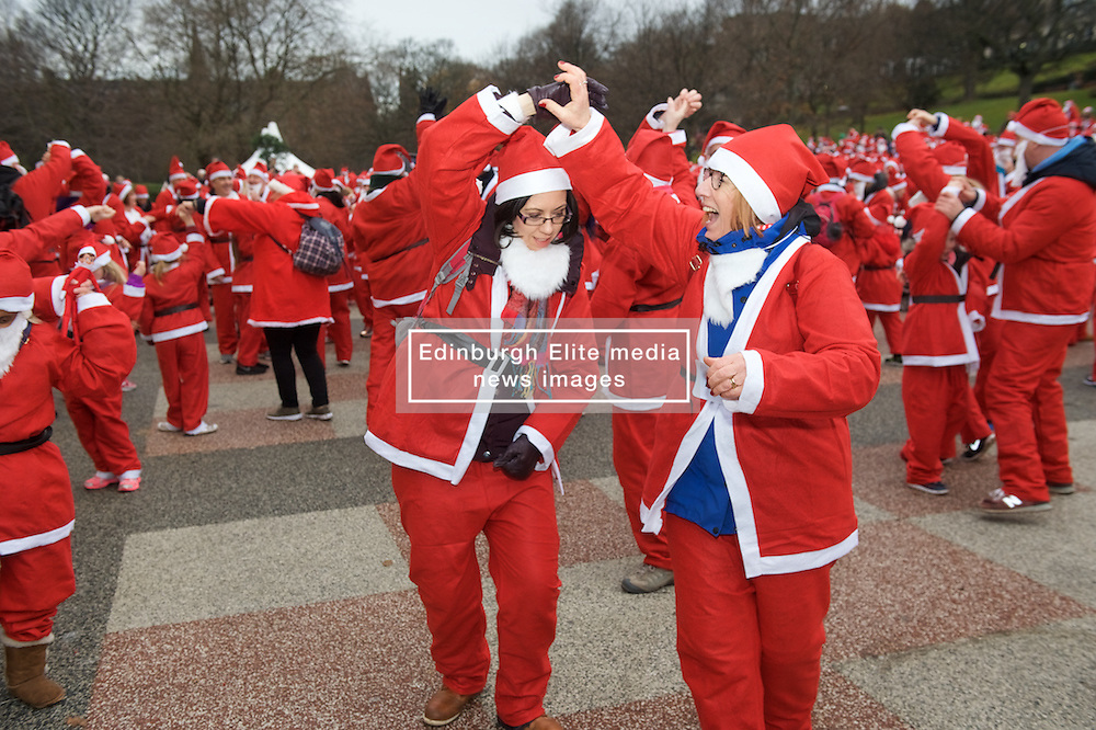 Over 1600 Santas complete a Gay Gordon warm up dance before Santa's takeing part in Scotland's fundraising Santa's run, walk and stroll around Edinburgh's West Prices Street Gardens, raising money to grant the Wishes of Children for When You Wish Upon A Star. Sunday 11th December 2016. (c) Brian Anderson   Edinburgh Elite media