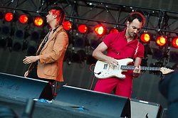 © Licensed to London News Pictures. 18/06/2015. London, UK.   The Strokes performing live at Hyde Park.   In this picture - Julian Casablancas (left), Albert Hammond Jr (right).  Photo credit : Richard Isaac/LNP