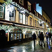 The Auberge du Trésor hotel and restaurant in Quebec City's Old Town decorated for Christmas. Night shot.