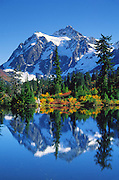 Mount Shuksan (9127 feet elevation in North Cascades National Park) reflects in Highwood Lake in Heather Meadows, in Mount Baker-Snoqualmie National Forest, near Bellingham, Washington, USA. Published in Sierra Magazine, Sierra Club Outings January/February 2002 and in 6 foot high poster for conference booth of University of Washington Department of Environmental & Occupational Health Sciences, Seattle.
