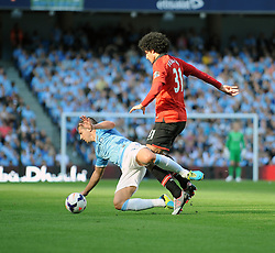 Manchester United's Marouane Fellaini fouls Manchester City's Matija Nastasic - Photo mandatory by-line: Dougie Allward/JMP - Tel: Mobile: 07966 386802 22/09/2013 - SPORT - FOOTBALL - City of Manchester Stadium - Manchester - Manchester City V Manchester United - Barclays Premier League