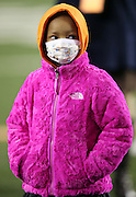 Leah Still, daughter of Cincinnati Bengals defensive tackle Devon Still (75), who was diagnosed with cancer, appears on the field while a donation in the amount of $1,349,582.63 is made to the Cincinnati Children's Hospital Medical Center from jerseys sold as part of the 2014 Devon Still Jersey Program during the NFL week 10 regular season football game against the Cleveland Browns on Thursday, Nov. 6, 2014 in Cincinnati. The Browns won the game 24-3. ©Paul Anthony Spinelli