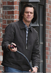 Jim Carrey waters the plants using a garden hose while filming scenes for a new movie in Studio City, Calif. on Tuesday. 22 May 2018 Pictured: Jim Carrey. Photo credit: GAC/MEGA TheMegaAgency.com +1 888 505 6342