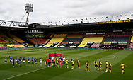 Both teams line up before in the empty stadium before the Premier League match at Vicarage Road, Watford. Picture date: 20th June 2020. Picture credit should read: Darren Staples/Sportimage
