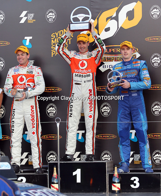 Jamie Whincup (TeamVodafone Holden) with Craig Lowndes and Mark Winterbottom. Sydney Motorsport Park 360 ~ Race 19 2012 V8 Supercar Championship Series. Sydney Motorsport Park, Sydney on Sunday 26 August 2012. Photo: Clay Cross / photosport.co.nz