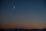 Between the moon and the mountains there's that band of blue. Is it a grayish blue or blueish gray.