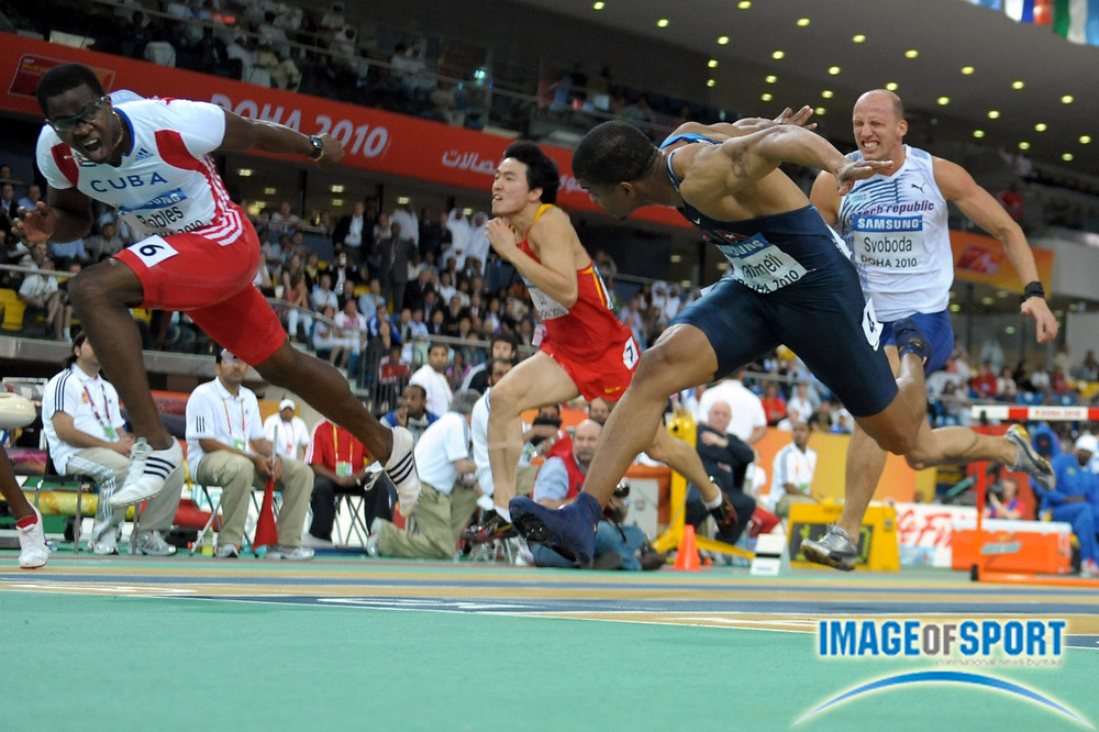 Mar 14, 2010; Doha, QATAR; Dayron Robles (CUB) left edges Terrence Trammell (USA), right, to win the 60m hurdles, 7.34 to 7.36, in the IAAF World Indoor Championships at the Aspire Dome.