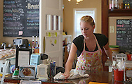 Co-owner Emily Hamilton wipes down the counter at The Kettel House Bakery & Cafe in Marion on Tuesday, June 18, 2013.