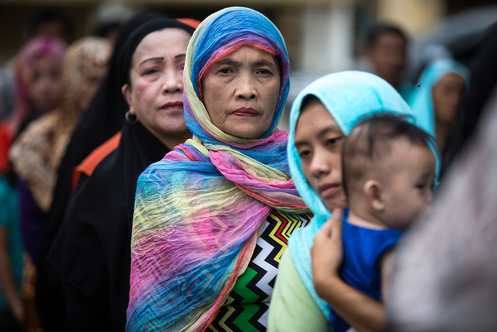 MARAWI, PHILIPPINES - JUNE 12: Muslim residents are seen during a symbolic flag raising ceremony in celebration of the Independence Day in Marawi City, Philippines on June 12, 2017. As fighting rages on for the third week, police hung Philippine flags  around war torn Marawi to boost troop morale. (Photo: Richard Atrero de Guzman/NUR Photo)<br />  <br /> <br /> <br /> Residents in tears during Lanao Del Sur Vice Governor Mamintal Adiong's emotional address to the displaced families of Marawi. Local executives and citizens gathered for a symbolic flag raising ceremony to assert civilian authority and unity in celebration of Independence Day in Marawi City, Philippines on June 12, 2017. (Photo: Richard Atrero de Guzman/NUR Photo)