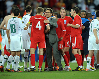 Fabio Capello Manager Congratulates Captain Steven Gerrard after the final whistle<br /> England World Cup 2010<br /> Slovenia V England (0-1) 23/06/10 Group C at the Nelson Mandela Bay/Port Elizabeth Stadium FIFA World Cup 2010<br /> Photo Robin Parker Fotosports International