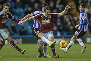 Joey Barton (Burnley) is tackled from behind during the Sky Bet Championship match between Sheffield Wednesday and Burnley at Hillsborough, Sheffield, England on 2 February 2016. Photo by Mark Doherty.