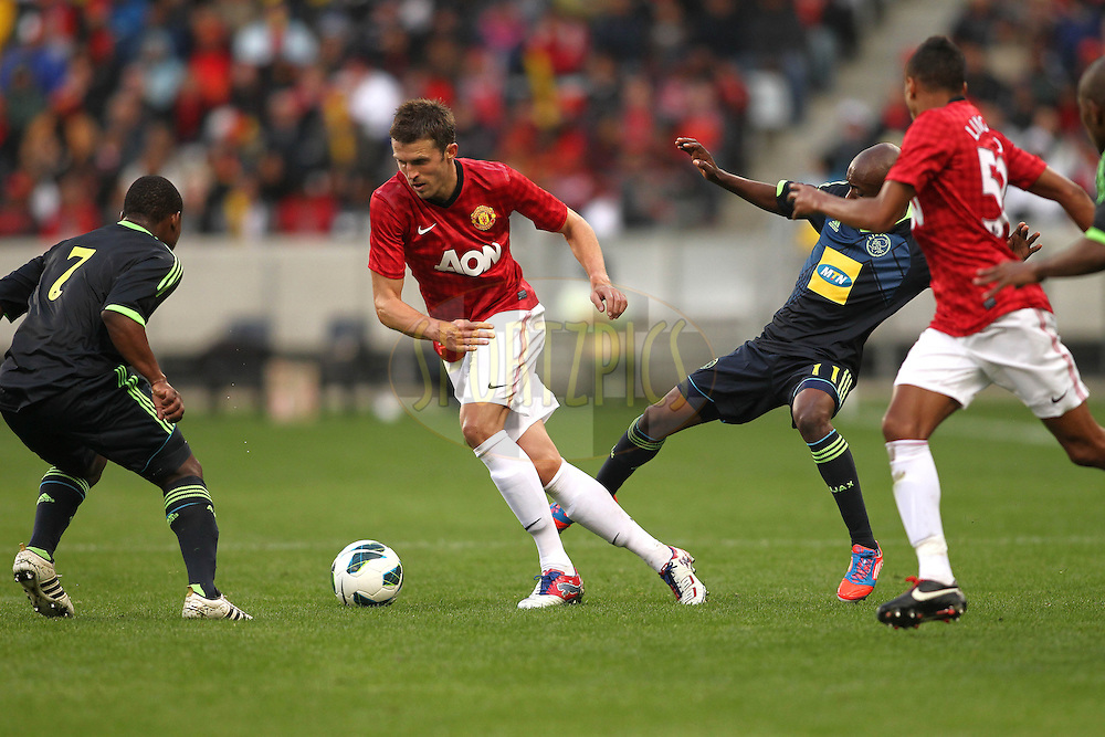 Javier Hernandez of Manchester United on the attack during the Football Invitational 2012 match between Ajax Cape Town and Manchester United held at Cape Town Stadium on 21 July 2012 in Cape Town, South Africa..Photo by Shaun Roy / Sportzpics