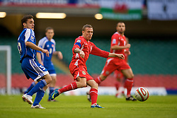 CARDIFF, WALES - Saturday, October 11, 2008: Wales' captain Craig Bellamy and Liechtenstein's Andreas Gerster during the 2010 FIFA World Cup South Africa Qualifying Group 4 match at the Millennium Stadium. (Photo by David Rawcliffe/Propaganda)