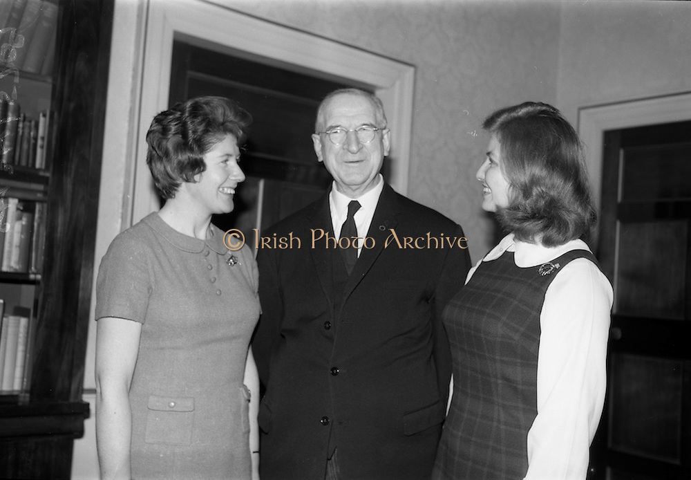 12/11/1964<br /> 11/12/1964<br /> 12 November 1964<br /> <br /> President de Valera Chatting with two of the students, Miss Madge O'Brien of Dungarvan Co. Waterford who recently returned from a visit to Farms in the U.S. and Miss Jean Thomas of Floyd Co. Virginia who has completed a five month visit to Farms in Ireland