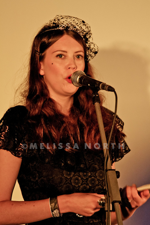 Performer live on stage in the Literary Lounge at Standon Calling, Herts, UK on 13 August 2011. JPH/B2779