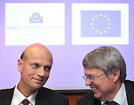 Rasmus Ruffer from the European Central Bank, left and European Union delegation leader Jurgen Kruger,right,  react at the end of  their news conference in Lisbon May 5, 2011. The rate on the European Union bailout loan to Portugal will be decided at a mid-May meeting of finance ministers, but it could be slightly lower than that applied to Greece, EU mission head Kruger said on Thursday.( Joao Henriques / 4SEE Photo )