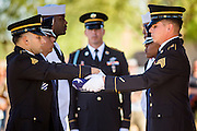 08 OCTOBER 2013 - PHOENIX, AZ: Members of an interservice honor guard unit fold an American flag during a ceremony honoring the cremated remains of US military veterans at the National Memorial Cemetery in Phoenix. The cremated remains of 36 unclaimed US military veterans were interred at the National Memorial Cemetery in Phoenix. Members of the US military and several hundred veterans of the US military attended the service, which was a part of the Missing In America Project (MIAP).    PHOTO BY JACK KURTZ