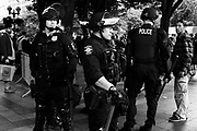 Seattle Police stand guard at the Freedom Rally and counter-protest at Westlake Park. Seattle, WA. August 13, 2017.
