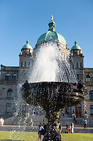 Water Fountain in front of Legislature sprays clean water on a sunny summer day.