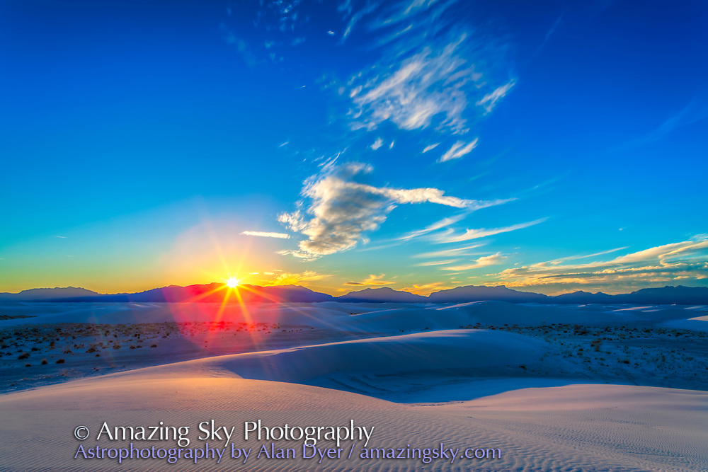 The setting Sun at White Sands National Monument, Dec 10, 2013. This is an HDR stack of 6 exposures at 2/3rds stop increments from -2 to +1.3 stops, with the Canon 24mm lens at Canon 5D MkII, and processed with Photomatix Pro.