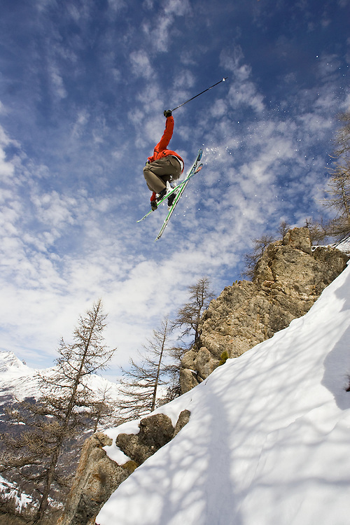 Skier jumping off rock, Serre Chevalier, France