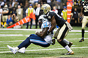 NEW ORLEANS, LA - NOVEMBER 8:  Delanie Walker #82 of the Tennessee Titans catches a pass in the end zone in front of Delvin Breaux #40 of the New Orleans Saints at Mercedes-Benz Superdome on November 8, 2015 in New Orleans, Louisiana.  The Titans defeated the Saints in overtime 34-28.  (Photo by Wesley Hitt/Getty Images) *** Local Caption *** Delanie Walker; Delvin Breaux
