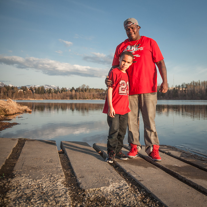 """My wife and I grew up here but we are considering a job with my employer in Ogden Utah.  The pay would be the same, but the cost of living would be greatly reduced."" - Medical equipment truck driver Quincy Bolling with his six year old son Quincy, at Westchester Lagoon, Anchorage"