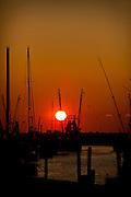 Sunset over shrimping boats along Shem Creek Mt Pleasant, SC