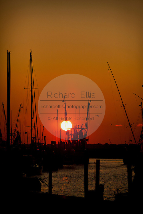 Sunset over shrimping boats along Shem Creek Mt Pleasant, SC