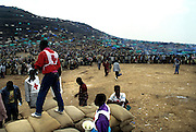 Goma Democrati Republic of Congo - International humanitarian workers distributing food. Kibumba refugee camp, this camp contained over 250,000 people. The Rwandan refugee crisis put severe pressure on the park. Nearly 1 million refugees were camped in the area around Goma and surrounding the park. ©Jean-Michel Clajot