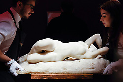 "© Licensed to London News Pictures. 10/02/2017. London, UK.  Technicians position ""La Grande Nevrose"" by Jacques Loysel (est. GBP120-180k), at the preview of the ""Erotic: Passion & Desire"" sale at Sotheby's in New Bond Street.  The sale, which will take place on 16 February, encompasses representations of love and sex from antiquity to the present day.  Photo credit : Stephen Chung/LNP"