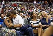 """16.JULY.2012. WASHINGTON<br /> <br /> PRESIDENT BARACK OBAMA KISSES FIRST LADY MICHELLE OBAMA FOR THE """"KISS CAM"""" WHILE ATTENDING THE U.S. MEN'S OLYMPIC BASKETBALL TEAM'S GAME AGAINST BRAZIL AT THE VERIZON CENTER IN WASHINGTON, D.C., JULY 16, 2012. VICE PRESIDENT JOE BIDEN AND MALIA OBAMA LOOK UP AT THE JUMBOTRON.<br /> <br /> BYLINE: EDBIMAGEARCHIVE.CO.UK<br /> <br /> *THIS IMAGE IS STRICTLY FOR UK NEWSPAPERS AND MAGAZINES ONLY*<br /> *FOR WORLD WIDE SALES AND WEB USE PLEASE CONTACT EDBIMAGEARCHIVE - 0208 954 5968*"""