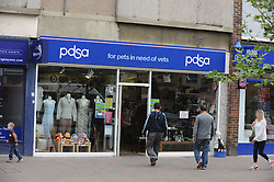 © London News Pictures. 14/07/2013. COPY AVAILABLE BELOW….  PDSA charity shop on Orpington High Street, Kent. Orpington High street now has 12 charity shops  in one short stretch, with Cancer Research UK having two shops on different sides of the high street almost facing each other.  COPY AVAILABLE HERE:  http://tinyurl.com/nhtxtyd<br /> <br /> Photo credit :Grant Falvey/LNP