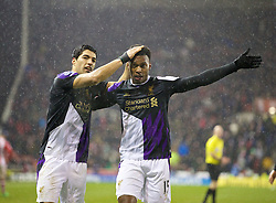 STOKE-ON-TRENT, ENGLAND - Sunday, January 12, 2014: Liverpool's Daniel Sturridge celebrates scoring the fifth goal against Stoke City with team-mate Luis Suarez during the Premiership match at the Britannia Stadium. (Pic by David Rawcliffe/Propaganda)