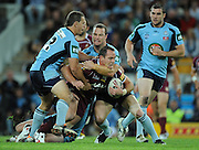 May 25th 2011: Matthew Scott of the Maroons is tackled during game 1 of the 2011 State of Origin series at Suncorp Stadium in Brisbane, Australia on May 25, 2011. Photo by Matt Roberts/mattrIMAGES.com.au / QRL