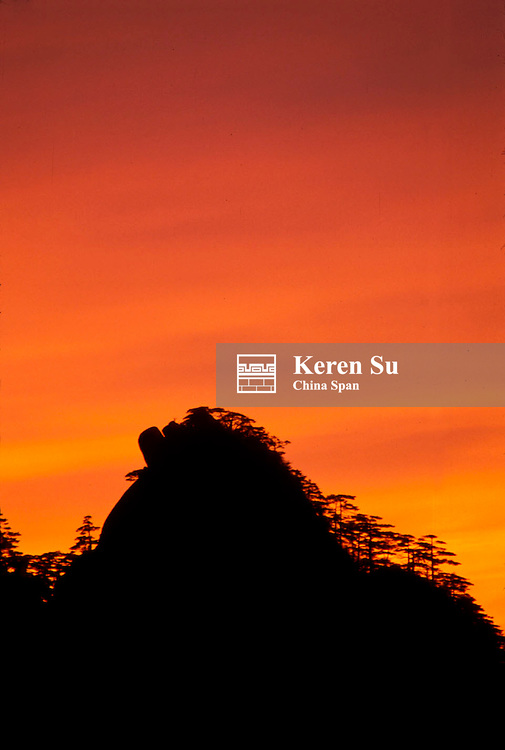 Silhouette of mountain peaks at sunset, Mt. Huangshan (Yellow Mountain), Anhui Province, China