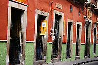 Doors line a street in Guanajuato, Mexico