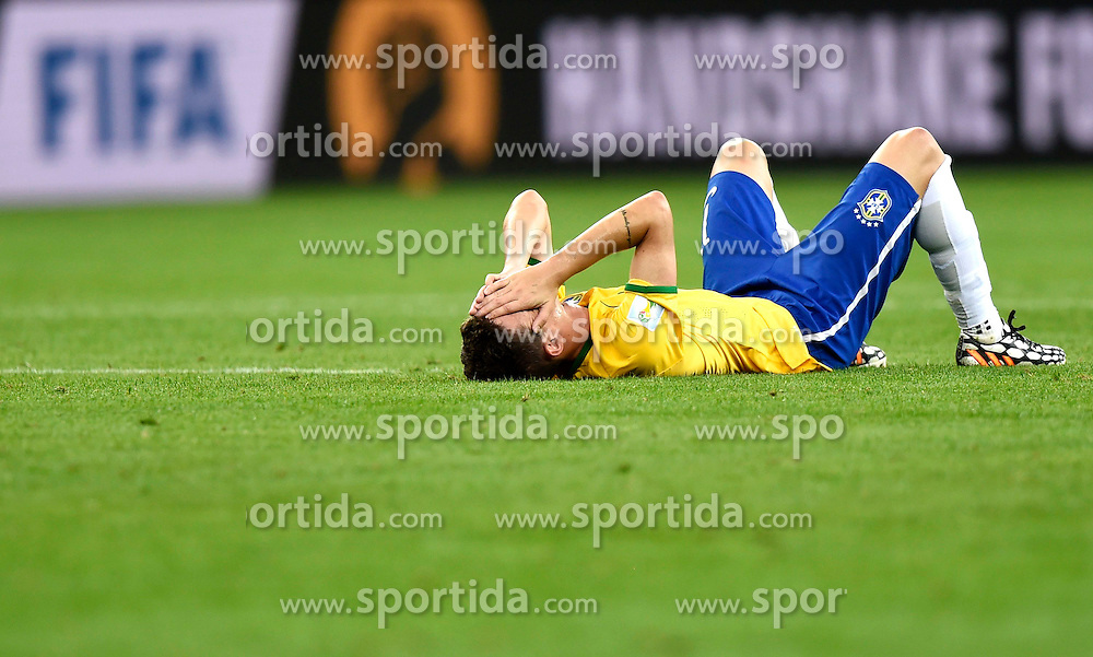 08.07.2014, Mineirao, Belo Horizonte, BRA, FIFA WM, Brasilien vs Deutschland, Halbfinale, im Bild Brazil's Oscar lies on the field // during Semi Final match between Brasil and Germany of the FIFA Worldcup Brazil 2014 at the Mineirao in Belo Horizonte, Brazil on 2014/07/08. EXPA Pictures &copy; 2014, PhotoCredit: EXPA/ Photoshot/ Qi Heng<br /> <br /> *****ATTENTION - for AUT, SLO, CRO, SRB, BIH, MAZ only*****