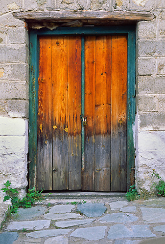 Stepping Stones Lead To An Old Wood Door With Faded Orange Stain And Blue Green Trim & Mds Wood Doors u0026 Atelier Pierre Thibault Designs A Contemporary ... pezcame.com