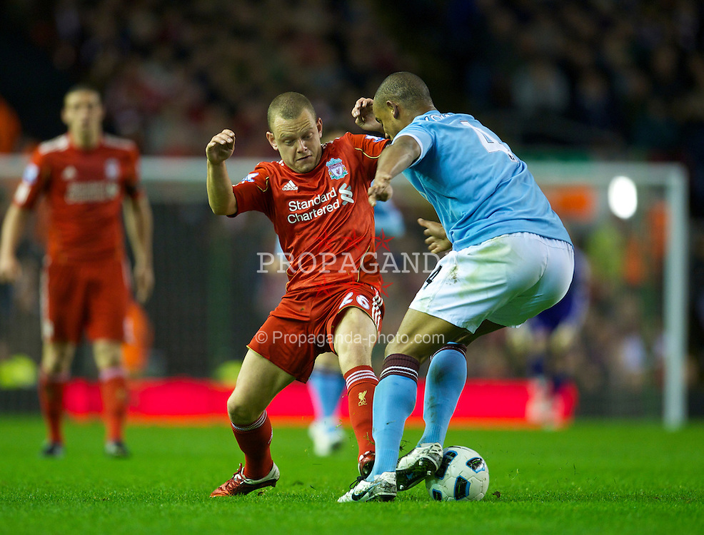 LIVERPOOL, ENGLAND - Monday, April 11, 2011: Liverpool's Jay Spearing and Manchester City's Vincent Kompany during the Premiership match at Anfield. (Photo by David Rawcliffe/Propaganda)