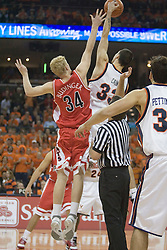 Virginia's Jason Cain (33) wins the opening tip against Arizona's Chase Budinger (34).   UVA defeated the #10 ranked Wildcats 93-90 in the first game at the new John Paul Jones Arena, in Charlottesville, VA on November 12, 2006...