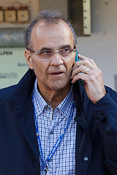 OAKLAND, CA - JUNE 14:  Major League Baseball executive and former manager Joe Torre talks on a cell phone in the dugout before the game between the Oakland Athletics and the New York Yankees at O.co Coliseum on June 14, 2014 in Oakland, California. The Oakland Athletics defeated the New York Yankees 5-1.  (Photo by Jason O. Watson/Getty Images) *** Local Caption *** Joe Torre