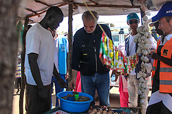 EU Commissioner CHRISTOS STYLIANIDES at a local market in BidiBidi settlement after he announced €78 million in humanitarian aid to South Sudan after visit to Uganda. During the trip, the Commissioner went to BidiBidi settlement in Northern Uganda, now the third largest refugee settlement in the world. It currently holds more than 210,000 South Sudanese refugees escaping from war, and the ongoing influx of a daily average of 3,000 refugees is causing a strain on humanitarian aid and funding.