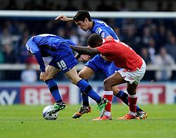 Bristol City's Mark Little is challenged by Rochdale's Ian Henderson  - Photo mandatory by-line: Dougie Allward/JMP - Mobile: 07966 386802 23/08/2014 - SPORT - FOOTBALL - Manchester - Spotland Stadium - Rochdale AFC v Bristol City - Sky Bet League One