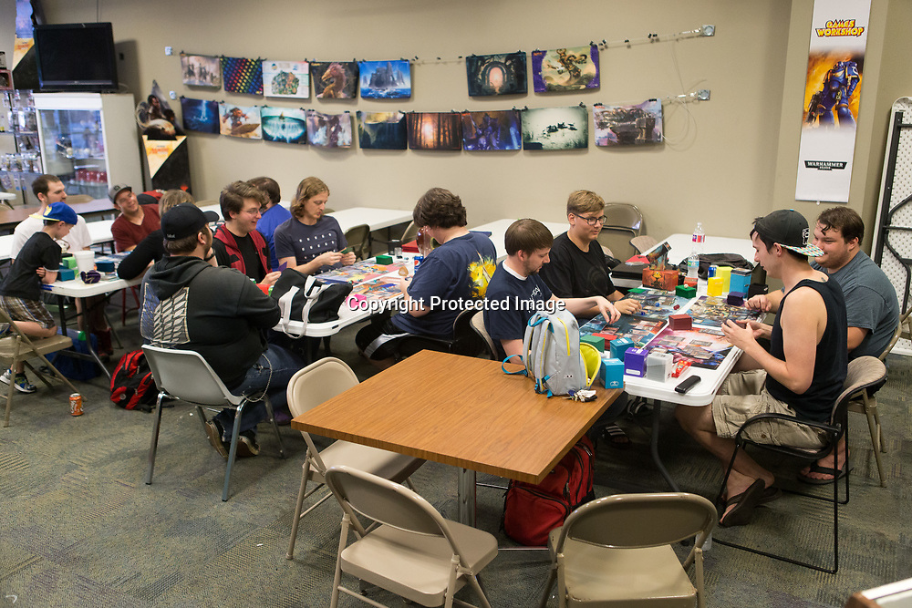 Pods of three and four people play the commander format of Magic: The Gathering Tuesday night at Tupelo Sportscards and Games. The store also hosts weekly Yu-Gi-Oh! card and Pokémon card tournaments.
