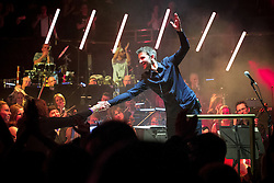 "© Licensed to London News Pictures . 05/02/2016 . Manchester , UK . Conductor TIM CROOKS . "" Hacienda Classical "" debut at the Bridgewater Hall . The 70 piece Manchester Camerata and performers including New Order's Peter Hook , Shaun Ryder , Rowetta Idah , Bez and Hacienda DJs Graeme Park and Mike Pickering mixing live compositions . Photo credit : Joel Goodman/LNP"