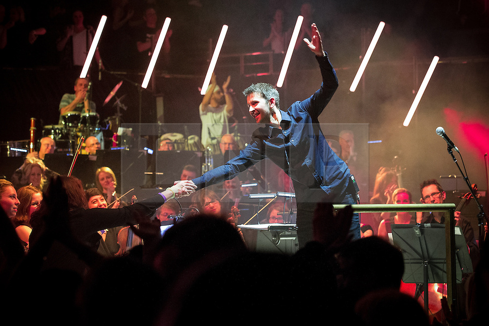 """© Licensed to London News Pictures . 05/02/2016 . Manchester , UK . Conductor TIM CROOKS . """" Hacienda Classical """" debut at the Bridgewater Hall . The 70 piece Manchester Camerata and performers including New Order's Peter Hook , Shaun Ryder , Rowetta Idah , Bez and Hacienda DJs Graeme Park and Mike Pickering mixing live compositions . Photo credit : Joel Goodman/LNP"""