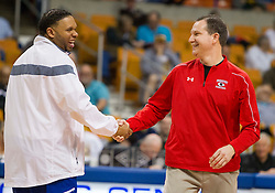 Bridgeport head coach Paul Ayers and Fairmont Senior head coach Corey Hines meet at half court before the start of their game.