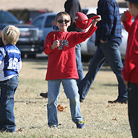 Lauren Wood | Buy at photos.djournal.com<br /> Coen McKnight, 7, of Hernando holds up the football he caught in his hat while playing catch with his baseball coach at his family's tailgate Saturday morning before the University of Memphis game in Memphis. Coen wanted to support Ole Miss like his friends on his baseball team, despite his parents being Memphis fans.