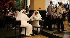 Emirati men drinking coffee